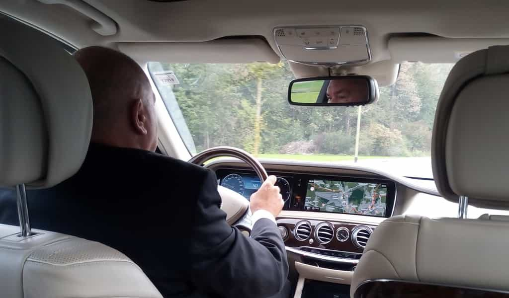 limousine chauffeur driving
