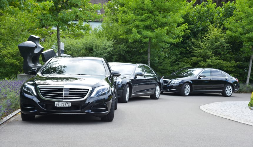 three mercedes event transport cars waiting on drive way