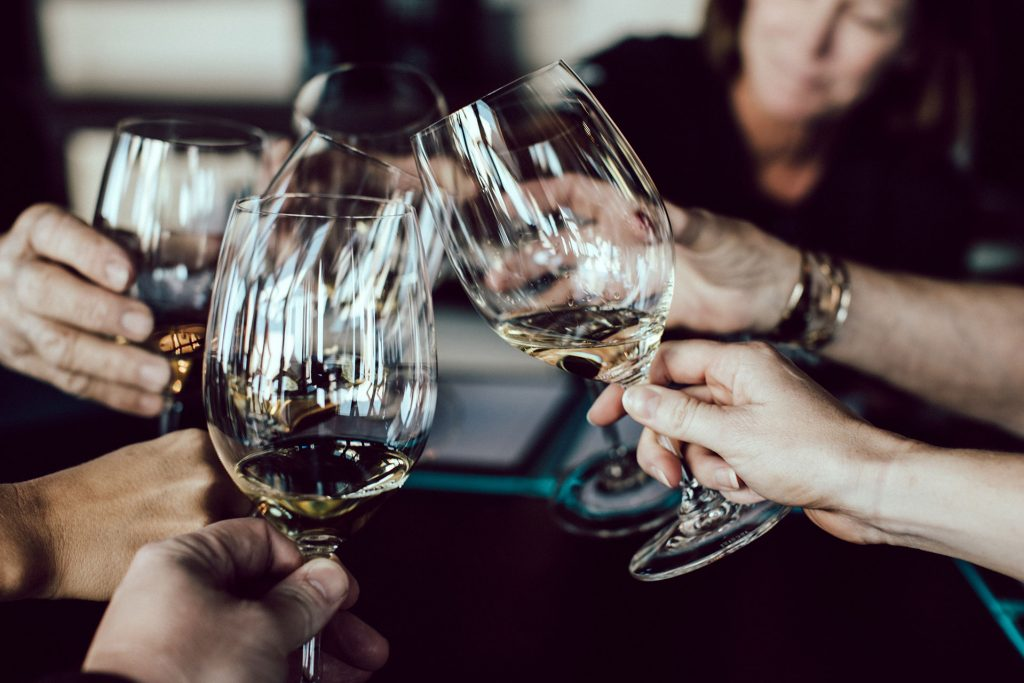 successful business dinner - toast - wine glasses
