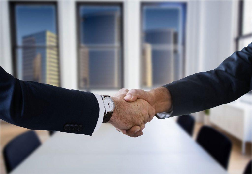 shaking hands - handshake - suit – wristwatch