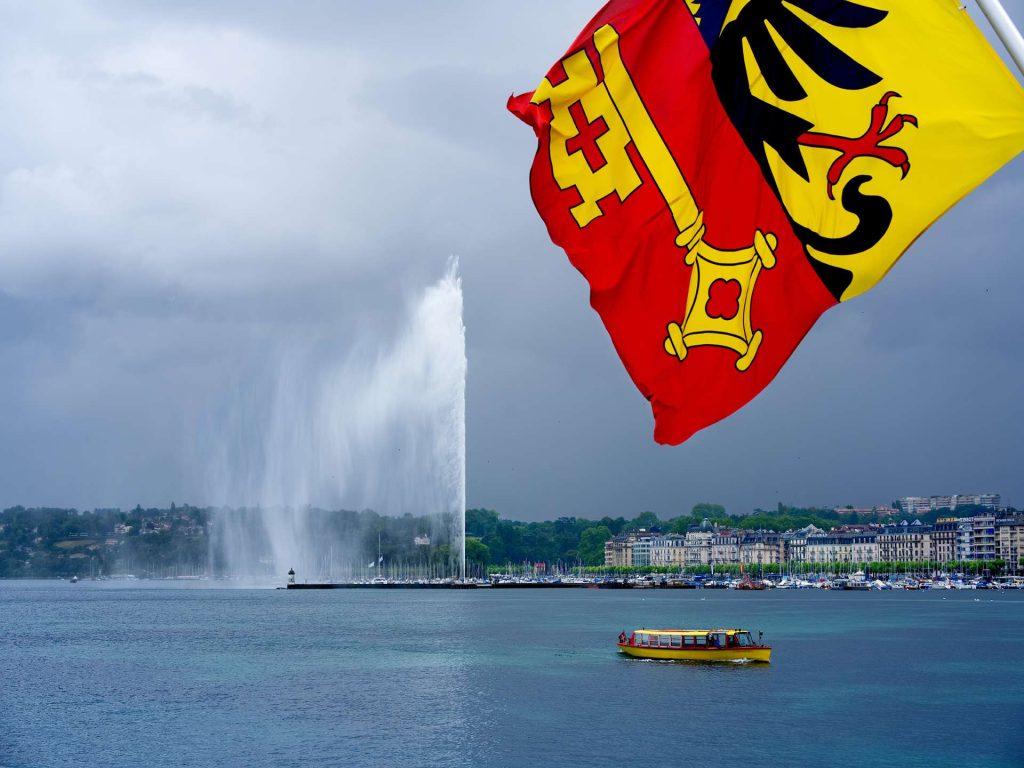 jet d'eau - geneva flag - lake geneva - boat