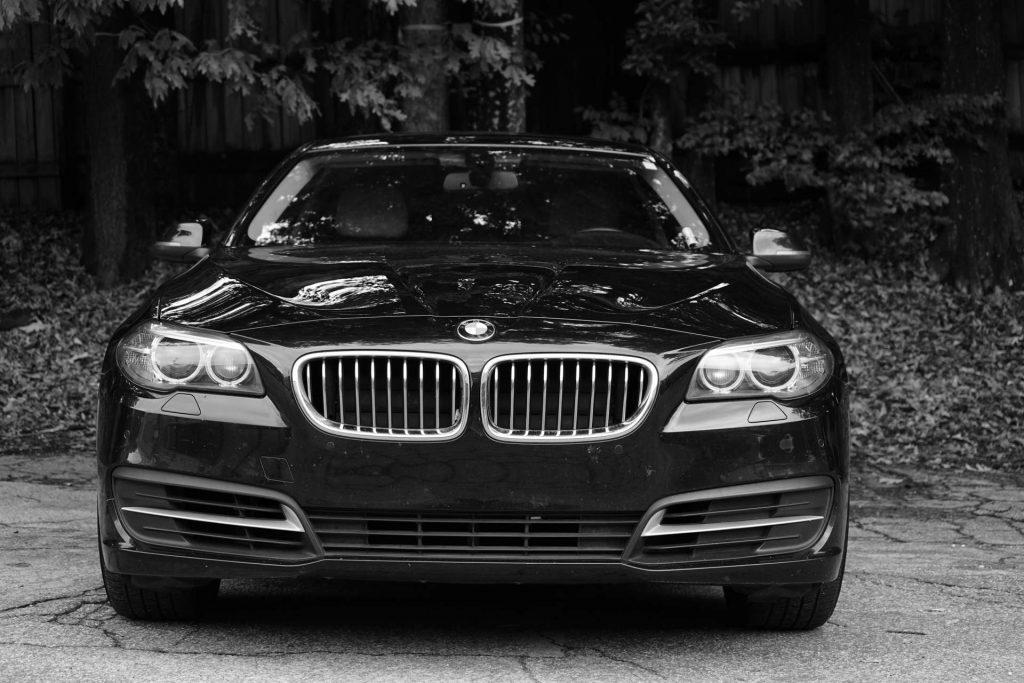 luxury travel - luxury car - bmw - black and white photo