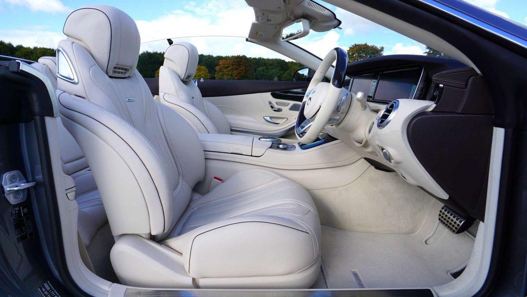 white luxury interior of a car - white leather seats