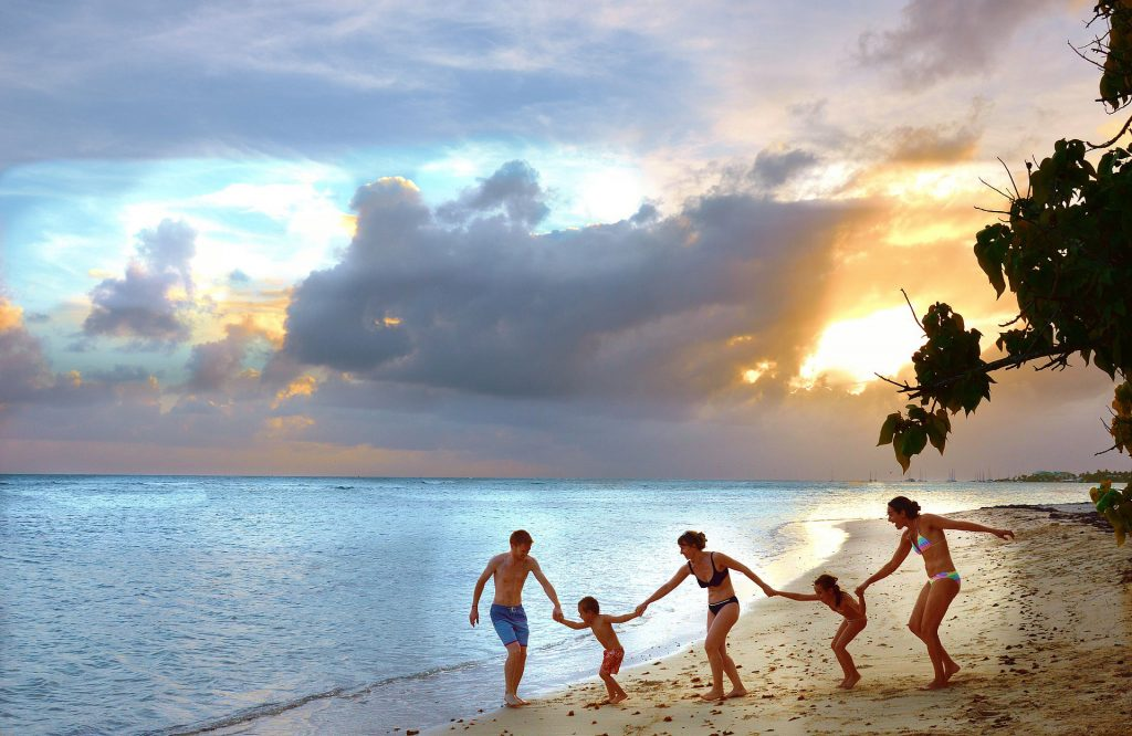 family holidays - beach - family - holding hands - sunset