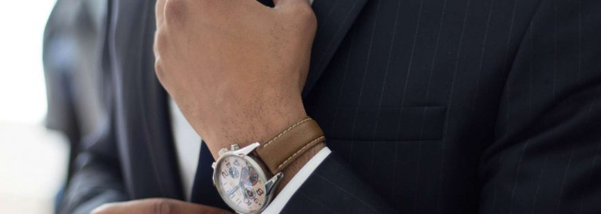 chauffeur services - men suit - wrist watch