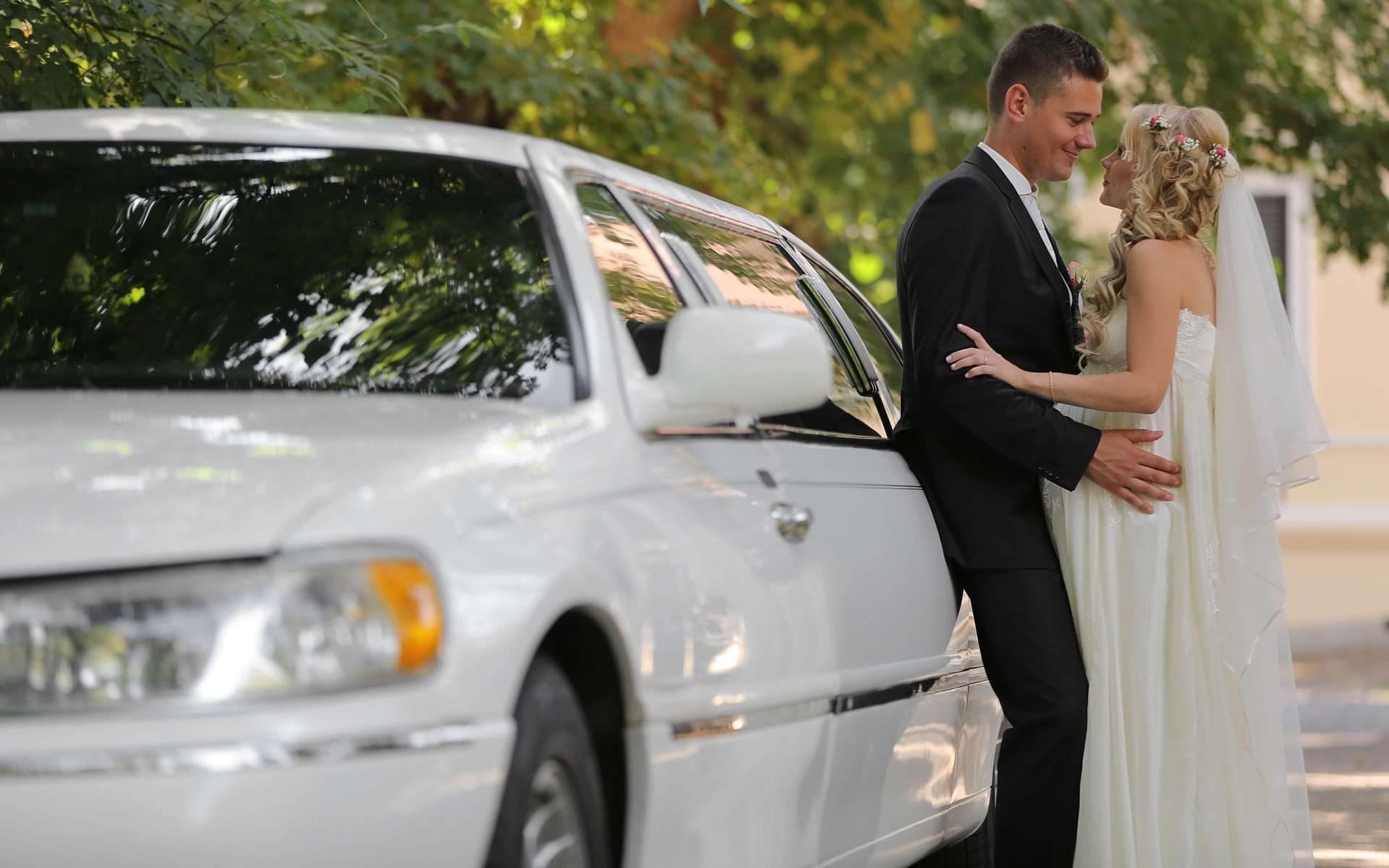 white limo - bride and groom - wedding - wedding limo price
